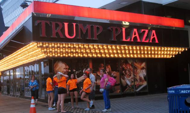 This July 24, 2014 photo shows several lights burned out in the illuminated facade of the Trump Plaza Hotel Casino in Atlantic City, N.J. On Tuesday Aug. 5, 2014, Donald Trump sued Trump Entertainment Resorts, seeking to force the company to remove his name from its two Atlantic City casinos, Trump Plaza and the Trump Taj Mahal, alleging the company had allowed the casinos to fall into disrepair and tarnish the real estate mogul's personal brand. (AP Photo/Wayne Parry)