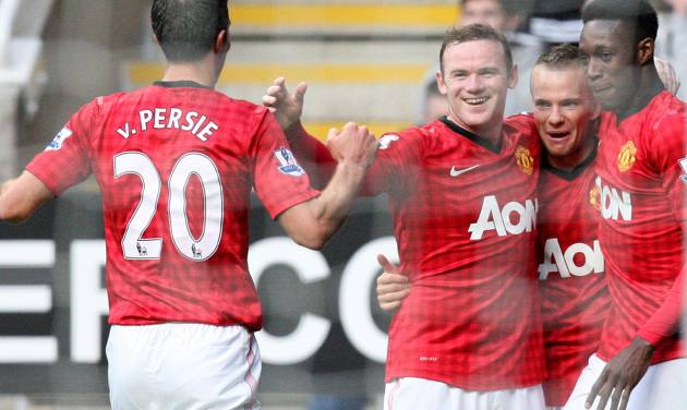 Manchester United's Tom Cleverley, second right, celebrates his goal with his teammates during their English Premier League soccer match against Newcastle United at the Sports Direct Arena, Newcastle, England, Sunday, Oct. 7, 2012. (AP Photo/Scott Heppell)