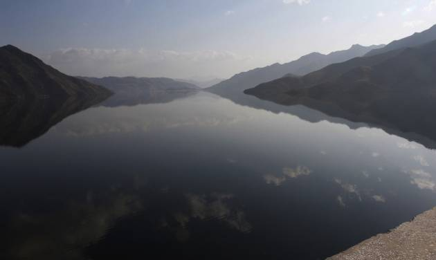 Clouds are reflected on a reservoir beneath the Huichon Power Station in Huichon City, some 250 kilometers (155 miles) north of the capital, Pyongyang, during an opening ceremony for the facility Thursday, April 5, 2012. The Huichon Power Station, under construction for more than three years, was a favored project of late leader Kim Jong Il, who visited the project five times before his death in December. The opening was the first big ceremony in a month of celebrations timed for the April centenary of the birth of late President Kim Il Sung. (AP Photo/Kim Kwang Hyon)