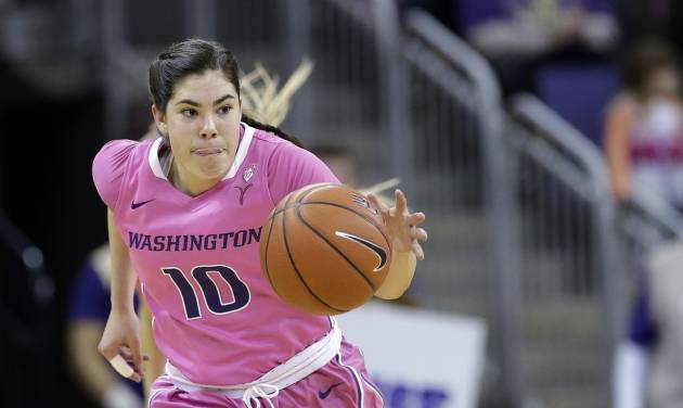 Washington's Kelsey Plum (10) races up court against Stanford in the first half of an NCAA women's basketball game, Sunday, Feb. 9, 2014, in Seattle. (AP Photo/Elaine Thompson)