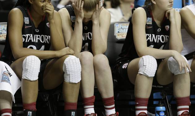 Stanford's Erica McCall, Taylor Greenfield and Karlie Samuelson, from left, sit on the bench  during the second half of the semifinal game against Connecticut in the Final Four of the NCAA women's college basketball tournament, Sunday, April 6, 2014, in Nashville, Tenn. Connecticut won 75.56. (AP Photo/Mark Humphrey)