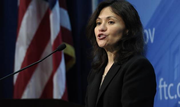 Federal Trade Commission (FTC) Chair Edith Ramirez speaks at the FTC in Washington, Wednesday, Jan. 15, 2014, where she announced Apple will refund $32.5 million to consumers to settle a federal case involving purchases that kids made without their parents' permission while playing on mobile apps. (AP Photo/Susan Walsh)