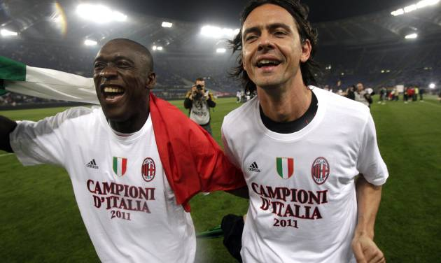 FILE -- In this file photo taken on May 7, 2011, AC Milan's Clarence Seedorf, left, and  Filippo Inzaghi celebrate after the Serie A soccer match between AS Roma and AC Milan at Rome's Olympic stadium. Real Madrid's Champions League winning coach, Carlo Ancelotti, has backed former player Filippo Inzaghi as the ideal candidate to take over as manager of AC Milan.Current Milan coach Clarence Seedorf is only four months into a 2 ½ year contract, but Italian media reports claim that club owner Silvio Berlusconi has already decided to replace him with the Dutchman's former teammate, Inzaghi. (AP Photo/Pier Paolo Cito)