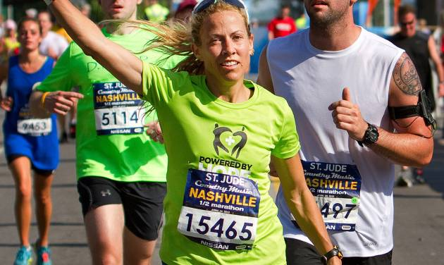 In this photo provided by the Competitor Group, Sheryl Crow runs in the half marathon in Nashville on Saturday, April 28, 2012. (AP Photo/Competitor Group, Lester Cacho)