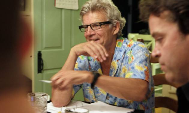 "In this photo taken Sunday Aug. 21, 2011 Academy Award winner Ernest Thompson goes over the script with his cast in New Hampton, N.H. Thirty years after the academy award winning movie, ""On Golden Pond"" hit theaters, its writer, Thompson is directing a new stage adaptation of the play in a tiny theater near where the movie was filmed. (AP Photo/Jim Cole)"