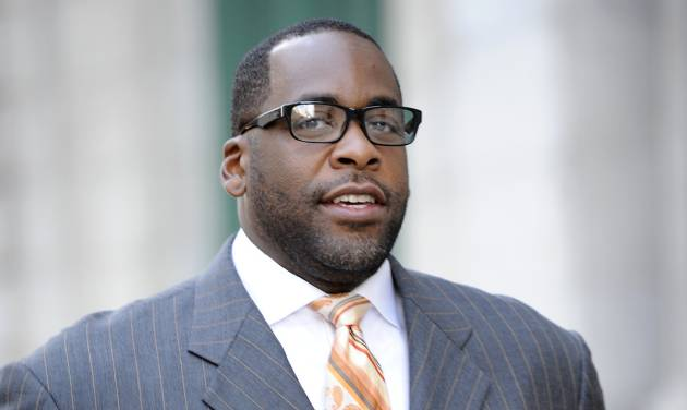 "FILE - In this Sept. 27, 2012 file photo, former Detroit mayor Kwame Kilpatrick makes his way to U.S. Federal Court in Detroit. Businessman Karl Kado, who held contracts at Detroit's convention center, said Monday, Dec. 3, 2012 that he was a ""hostage"" who felt compelled to pay thousands of dollars to then-Mayor Kwame Kilpatrick and his father or lose work. Kado told jurors that he personally delivered $5,000 to $10,000 to Kilpatrick ""three or four times."" He said he also delivered money through a top mayoral aide and separately paid $200,000 to $300,000 to Kilpatrick's father, Bernard. Kado is a crucial witness at the corruption trial, which began in September. (AP Photo/The Detroit News, David Coates)"