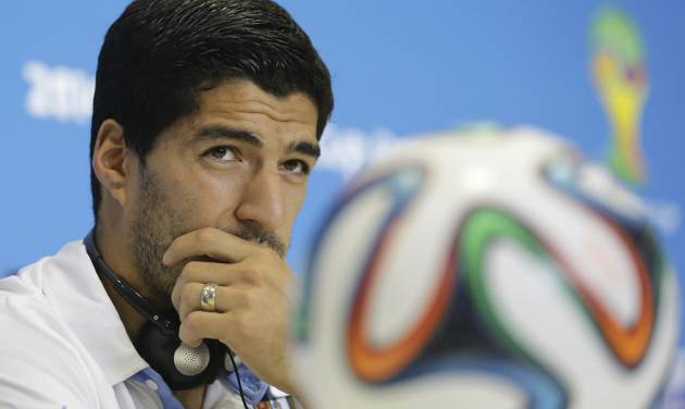 Uruguay's Luis Suarez listens to a question during a press conference, a day before his team's group D World Cup soccer match, at the Arena das Dunas in Natal, Brazil, Monday, June 23, 2014. (AP Photo/Antonio Clanni)