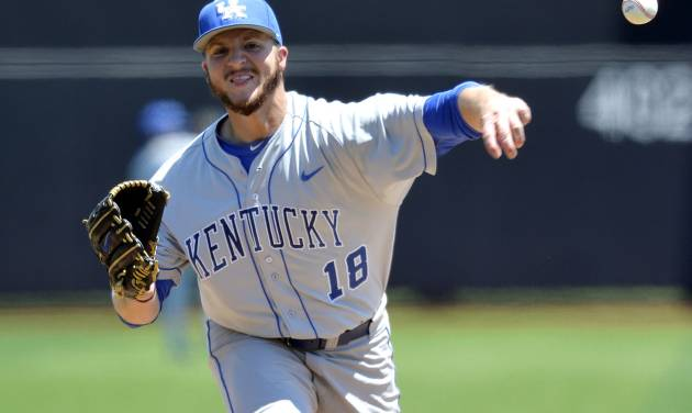 Kentucky's A.J. Reed pitches to Kent State during an NCAA college baseball regional tournament game in Louisville, Ky., Saturday, May 31, 2014. Kentucky won 4-2. (AP Photo/Timothy D. Easley)