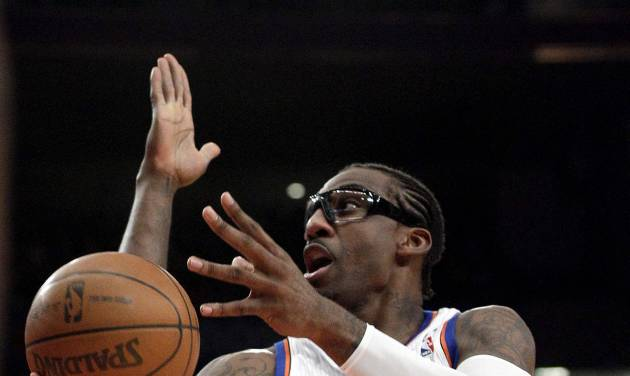 New York Knicks' Amare Stoudemire (1) drives past Los Angeles Clippers' Reggie Evans during the first half of an NBA basketball game, Wednesday, April 25, 2012, in New York. (AP Photo/Frank Franklin II)