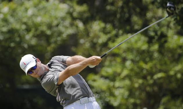 Zach Johnson watches his tee shot on the third hole during the second round of the U.S. Open golf tournament in Pinehurst, N.C., Friday, June 13, 2014. (AP Photo/Matt York)