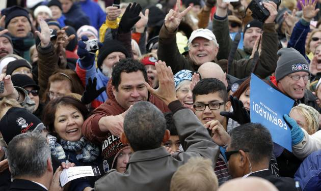 FILE - In this Thursday, Nov. 1, 2012 file photo, President Barack Obama greets supporters during a campaign stop at Austin Straubel International Airport in Green Bay, Wis. Kiss by kiss, handshake by handshake, Obama glides across the perimeter of a small tennis stadium, stooping over to embrace white-haired retirees wearing dark sunglasses and extending his arms to shake hands or touch the masses a few rows back. (AP Photo/Pablo Martinez Monsivais, File)