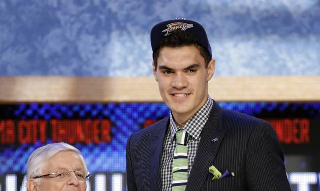 NBA Commissioner David Stern, left, shakes hands with Pittsburgh's Steven Adams, who was selected by the Oklahoma City Thunder in the first round of the NBA basketball draft, Thursday, June 27, 2013, in New York. (AP Photo/Kathy Willens)