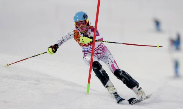 Lebanon's Jacky Chamoun skis in the first run of the women's slalom at the Sochi 2014 Winter Olympics, Friday, Feb. 21, 2014, in Krasnaya Polyana, Russia. (AP Photo/Charles Krupa)