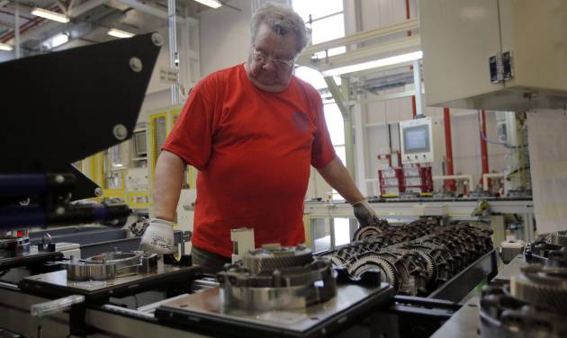 In this May 13, 2014 photo, Dave Roop, of Cicero, Ind., works on the line of a Chrysler transmission manufacturing facility in Tipton, Ind. The Institute for Supply Management releases its manufacturing index for May on Monday, June 2, 2014. (AP Photo/AJ Mast)