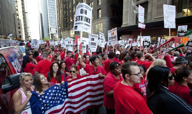 FILE - This Sept. 10, 2012, file photo shows thousands of public school teachers rallying outside the Chicago Public Schools district headquarters on the first day of strike action over teachers' contracts in Chicago. A majority of union members today now have ties to a government entity at the federal, state or local levels. The typical union worker now is more likely to be an educator, office worker or food or service industry employee rather than a construction worker, autoworker, electrician or mechanic, with far more women than men among the ranks. Overall, 11.3 percent of U.S. wage and salary workers are unionized, down from a peak of 35 percent during the mid-1950s.  (AP Photo/Sitthixay Ditthavong, File)