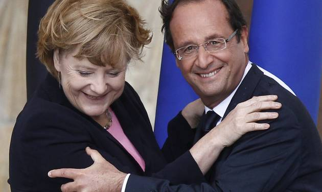 "FILE - In this July 8, 2012 file photo German Chancellor Angela Merkel, left, and French President Francois Hollande react after a speech in front of Reims cathedral, in Reims, eastern France. Merkel and Hollande said in a joint statement issued by the German government Friday, July 27, 2012 that their countries are ""deeply committed to the integrity of the eurozone."" They said eurozone members and European institutions ""must comply with their obligations, each in their own are of competence."" (AP Photo/Pool/Jacky Naegelen, File)"