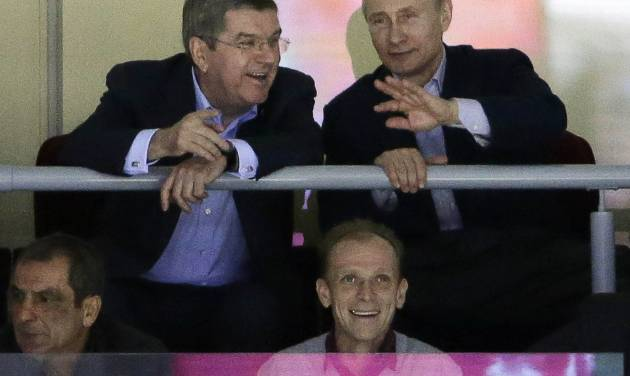 Russian President Vladimir Putin watches the USA Russia men's hockey game from a box at the 2014 Winter Olympics, Saturday, Feb. 15, 2014, in Sochi, Russia. (AP Photo/David J. Phillip )