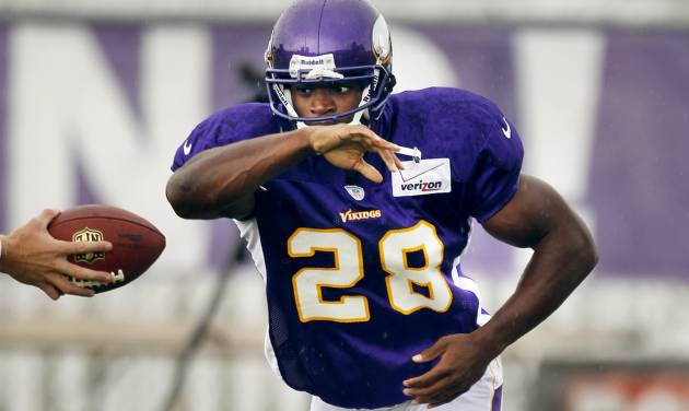 Minnesota Vikings running back Adrian Peterson takes a handoff during NFL football training camp, Tuesday, Aug. 14, 2012, in Mankato, Minn. (AP Photo/The Star Tribune, Jerry Holt) MANDATORY CREDIT; ST. PAUL PIONEER PRESS OUT; MAGS OUT; TWIN CITIES TV OUT