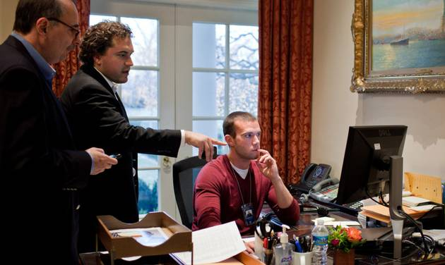 In this  Jan. 8, 2011 photo provided by the White House, from left, senior advisor David Axelrod, speechwriter Cody Keenan, and chief White House speechwriter Jon Favreau, work on President Barack Obama's statement concerning the shooting of Rep. Gabrielle Giffords and others in Tucson, Ariz., at the White House in Washington. When Obama needed a new head speechwriter, he turned to Keenan, a 32-year-old fellow Chicagoan. Favreau, who left in March 2013 after five years as the president's lead wordsmith, brought Keenan into Obama's orbit in the first place, as an unpaid summer intern in 2007. (AP Photo/The White House, Pete Souza)