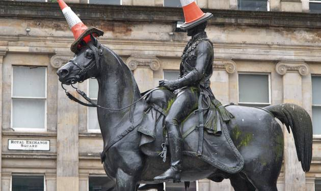 This undated photo shows a statue of the Duke of Wellington in Glasgow, Scotland. The statue is rarely seen without a traffic cone on its head. It started as a joke by students decades ago but is now an almost permanent symbol of local humor. Visiting the famous monument with its cones is one of a number of free things to see and do in Glasgow. (AP Photo/ Stewart Cunningham)