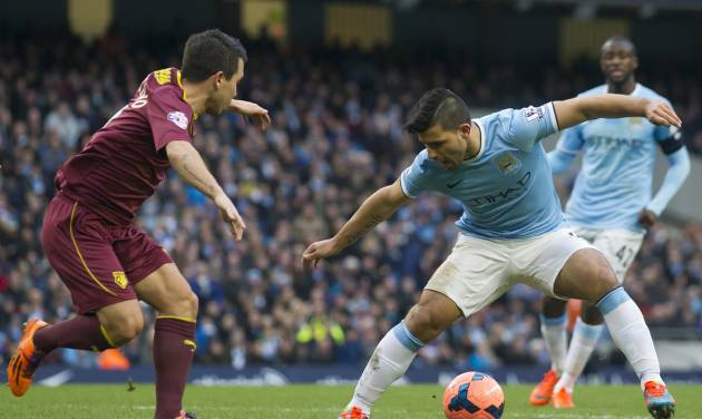 Manchester City's Sergio Aguero, right, keeps the ball from Watford's Cristian Battocchio during their English FA Cup fourth round soccer match at The City of Manchester Stadium, Manchester, England, Saturday, Jan. 25, 2014. (AP Photo/Jon Super)
