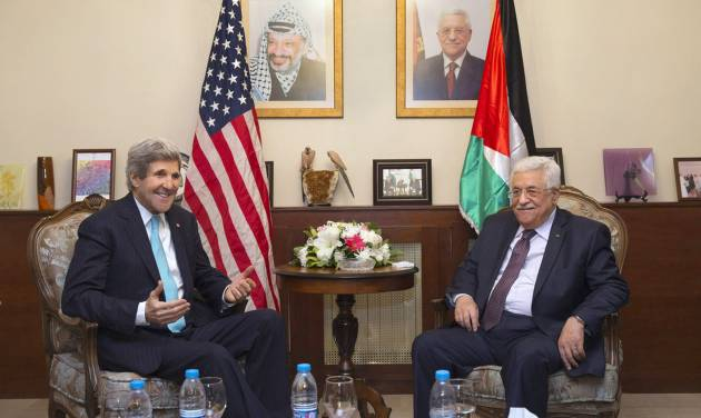 FILE - In this file photo taken Wednesday, March 26, 2014, U.S. Secretary of State John Kerry, left, meets with Palestinian President Mahmoud Abbas at the Palestinian Ambassador's Residence in Amman, Jordan, in an effort to salvage the Middle East peace talks as a breakdown looms.  (AP Photo/Jacquelyn Martin, Pool, File)
