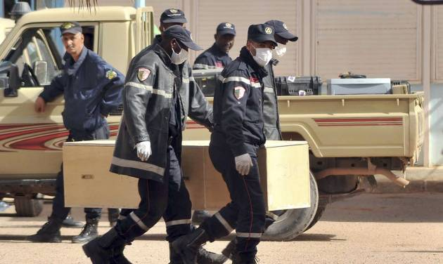 Algerian firemen carry a coffin containing a person killed during the gas facility hostage situation at the morgue in Ain Amenas, Algeria, Monday, Jan. 21, 2013. The Islamist militants who attacked the natural gas plant included two Canadians and a team of explosives experts who had memorized the layout of the sprawling complex and were ready to blow the place sky-high, Algeria's prime minister said Monday. Algeria detailed a grim toll from the attack, saying at least 38 hostages and 29 militants died in four days of mayhem. (AP Photo/Anis Belghoul)