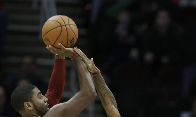 Milwaukee Bucks' Brandon Jennings (3) defends a shot by Cleveland Cavaliers' Kyrie Irving in the first quarter of an NBA basketball game Friday, Jan. 25, 2013, in Cleveland. (AP Photo/Mark Duncan)
