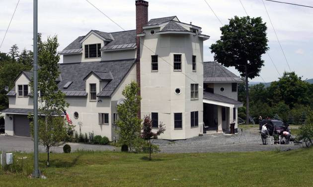 FILE - This June 18, 2007, file photo shows the home of Ed and Elaine Brown in Plainfield, N.H. The tax-evading couple are serving lengthy sentences after being convicted of amassing an arsenal of weapons and holding law enforcement at bay for nine months in 2007. Federal officials are set to auction on Friday, Aug. 15, 2014, the Brown's former fortress-like home sitting on more than 100 acres in Plainfield. Prospective bidders have not been allowed to tour the property. The U.S. Marshals Service cited the possibility of land mines and other explosives buried on the property as a complication. (AP Photo/Jim Cole, File)