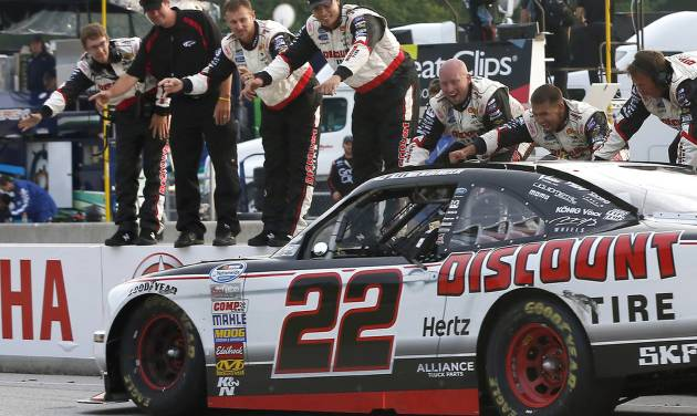 AJ Allmendinger celebrates with members of his team after winning the NASCAR Nationwide series Johnsonville Sausage 200 auto race at Road America, Saturday, June, 22, 2013, in Elkhart Lake, Wis. (AP Photo/Mike Roemer)