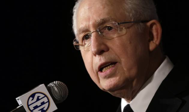 ADVANCE FOR WEEKEND EDITIONS, JUNE 7-8 - FILE - In this July 16, 2013 file photo, Southeastern Conference Commissioner Mike Slive talks with reporters during the SEC football Media Days in Hoover, Ala. The NCAA is in the midst of a radical restructuring that will likely result in the five wealthiest football conferences, comprising 65 schools, being allowed to make rules without the support of the other 286 schools that play Division I sports.(AP Photo/Dave Martin, File)