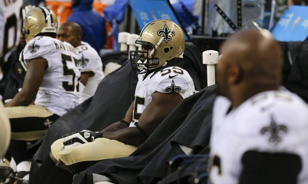 New Orleans Saints defensive end Keyunta Dawson sits on the bench during the fourth quarter of an NFC divisional playoff NFL football game against the Seattle Seahawks in Seattle, Saturday, Jan. 11, 2014. The Seahawks won 23-15. (AP Photo/Ted S. Warren)