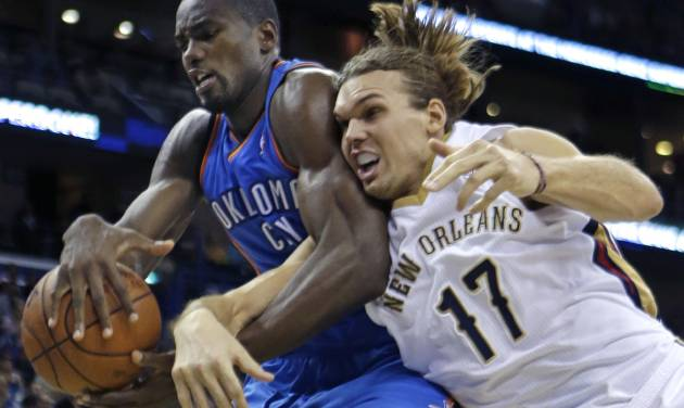 Oklahoma City Thunder power forward Serge Ibaka battles for a rebound with New Orleans Pelicans power forward Lou Amundson (17) in the second half of an NBA basketball game in New Orleans, Friday, Dec. 6, 2013.  The Thunder won 109-95. (AP Photo/Gerald Herbert)