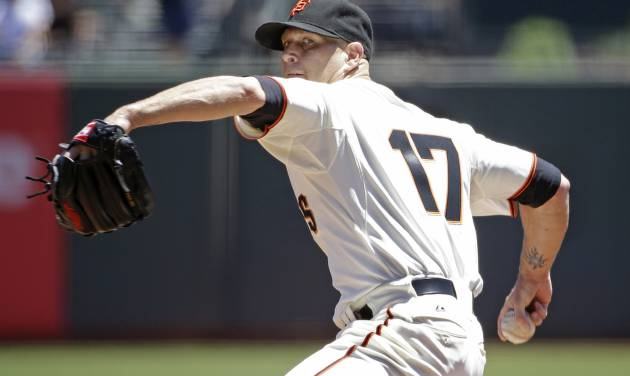 San Francisco Giants starting pitcher Tim Hudson throws against the Oakland Athletics in the first inning of their interleague baseball game Thursday, July 10, 2014, in San Francisco. (AP Photo/Eric Risberg)
