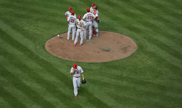 St. Louis Cardinals starting pitcher John Lackey, bottom, walks off the field after being relieved in the sixth inning of an interleague baseball game against the Baltimore Orioles, Saturday, Aug. 9, 2014, in Baltimore. (AP Photo/Patrick Semansky)