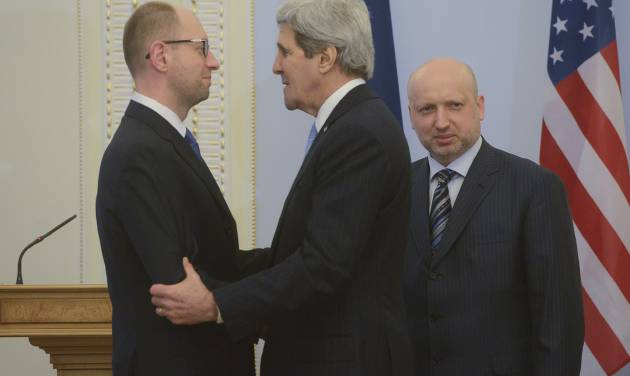 U.S. Secretary of State John Kerry, center,  greets Ukrainian Prime Minister Arseniy Yatsenyuk, left, parliament speaker Oleksandr Turchynov is seen right prior their meting in Kiev, Ukraine, Tuesday, March, 4, 2014.  In a somber show of U.S. support for Ukraine's new leadership, Secretary of State John Kerry walked the streets Tuesday where nearly 100 anti-government protesters were gunned down by police last month, and promised beseeching crowds that American aid is on the way.  The Obama administration announced a $1 billion energy subsidy package in Washington as Kerry was arriving in Kiev. (AP Photo/Andrew Kravchenko, pool)