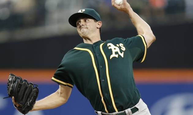 Oakland Athletics Brad Mills delivers inthe first inning of an interleague baseball game against the New York Mets in New York, Wednesday, June 25, 2014. (AP Photo/Kathy Willens)