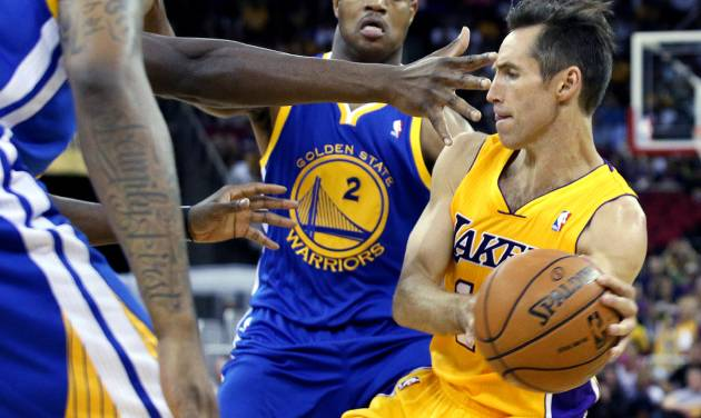 Los Angeles Lakers' Steve Nash, right, looks to pass against Golden State Warriors defenders including Jarrett Jack (2) during the first half of a preseason NBA basketball game in Fresno, Calif., Sunday, Oct. 7, 2012. (AP Photo/Gary Kazanjian)