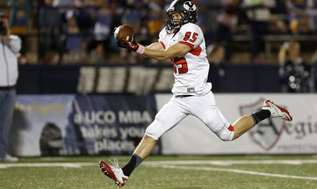 Yukon's Codey Sanchez catches a touchdown pass against Edmond North during a high school football game at Wantland Stadium in Edmond, Okla., Thursday, October 4, 2012. Photo by Bryan Terry, The Oklahoman