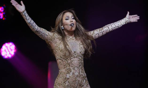 """In a March 23, 2013, file photo  Jennifer Lopez performs at  the JW Marriott Desert Ridge Resort and Spa  in Phoenix. Jennifer Lopez sang """"Happy Birthday"""" to the leader of Turkmenistan during a performance DSaturday June 29, 2013, but her representative says had she known there were human rights issues in the country, she wouldn't have performed there at all.(Photo by Rick Scuteri/Invision/AP, file)"""