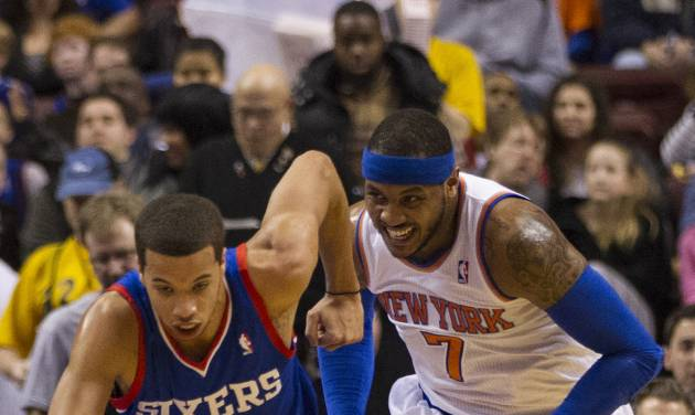 Philadelphia 76ers' Michael Carter-Williams drives up the court after getting the ball away from New York Knicks' Carmelo Anthony during the first half of an NBA basketball game, Saturday, Jan. 11, 2014, in Philadelphia.  (AP Photo/Chris Szagola)