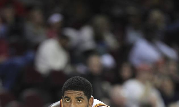 FILE - In this Oct. 13, 2012 file photo, Cleveland Cavaliers' Kyrie Irving waits for action to resume in an NBA preseason basketball game against the Washington Wizards Saturdaymin Cleveland. After a sensational first season, the NBA's ruling rookie of the year is poised to help the Cavs take another step toward respectability. (AP Photo/Tony Dejak, File)