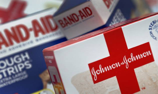 This Oct. 16 2012 photo shows Johnson and Johnson products, including Band Aid brand adhesive bandages, arranged for a photo in St. Petersburg, Fla. Johnson & Johnson reports quarterly financial results before the market opens on Tuesday, April 15, 2014. (AP Photo/Chris O'Meara)