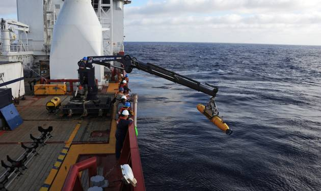 In a Monday, April 14, 2014 photo provided by the U.S. Navy, operators aboard the Australian defense vessel Ocean Shield move the U.S. Navy's Bluefin-21 autonomous underwater vehicle into position for deployment to search for the missing Malaysia Airlines Flight 370. On Tuesday, April 15, 2014, the U.S. Navy and search coordinators said that a built-in safety feature aborted what was supposed to have been a 16-hour mission to create a sonar map of the ocean floor after only six hours. (AP Photo/U.S. Navy, MC1 Peter D. Blair)