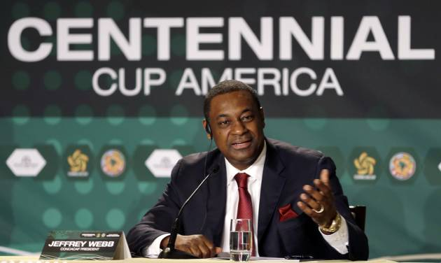 """FILE - A Thursday, May 1, 2014 photo from files showing Jeffrey Webb, FIFA Vice President, gesturing as he speaks during a news conference in Bal Harbour, Fla. Webb condemned """"deep rooted racism"""" in Italy on Wednesday, May 21, 2014, after Mario Balotelli was racially abused while training with the national team. A year after spearheading the strengthening of FIFA's discrimination sanctions, Webb is frustrated that some countries including Italy and Spain are not showing the commitment required to the fight against racism. (AP Photo/Alan Diaz, File)"""