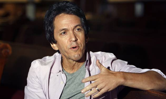 """FILE - This Oct. 1, 2009 file photo shows author Mitch Albom in Detroit. Albom has a three-book deal with Harper, an imprint of HarperCollins Publishers. Albom's previous publisher was the Disney-owned Hyperion. Albom's next book is called """"The First Phone Call from Heaven,"""" Harper told The Associated Press on Wednesday. The novel will tell of a small Michigan town where residents start receiving phone calls from those in the afterlife. His previous works include """"Have a Little Faith,"""" """"The Timekeeper"""" and """"The Five People You Meet in Heaven."""" (AP Photo/Carlos Osorio, file)"""