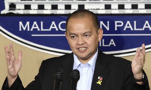 Philippine government negotiator Marvic Leonen gestures as he answers questions from reporters after meeting with Philippine President Benigno Aquino III at the Malacanang presidential palace in Manila, Philippines on Monday, Oct. 8, 2012. The Philippine government and the country's largest Muslim rebel group reached a preliminary peace deal that is a major breakthrough toward ending a decades-long insurgency that killed tens of thousands and held back development in the south. (AP Photo/Aaron Favila)