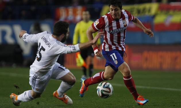 Atletico's Cristian Rodriguez in action with Real's Daniel Carvajal during a semi final, 2nd leg, Copa del Rey soccer derby match between Real Madrid and Atletico Madrid at the Vicente Calderon Stadium in Madrid, Tuesday Feb. 11 , 2014.  (AP Photo/Gabriel Pecot)