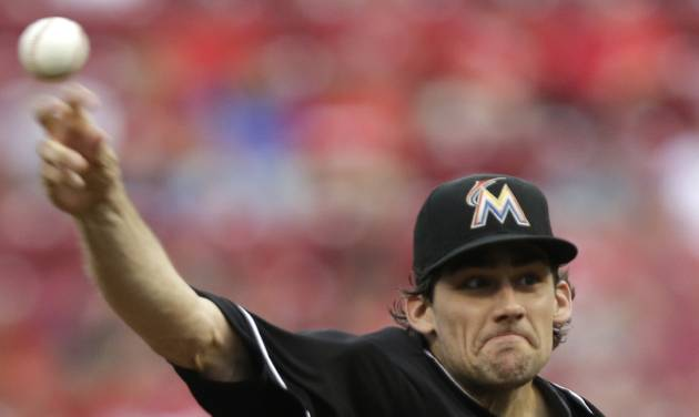 Miami Marlins starting pitcher Nathan Eovaldi throws against the Cincinnati Reds in the first inning of a baseball game, Friday, Aug. 8, 2014, in Cincinnati. (AP Photo/Al Behrman)