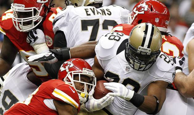 New Orleans Saints running back Pierre Thomas (23) carries as Kansas City Chiefs strong safety Eric Berry (29) tackles in the first half of an NFL football game at the Mercedes-Benz Superdome in New Orleans, Sunday, Sept. 23, 2012. (AP Photo/Jonathan Bachman)